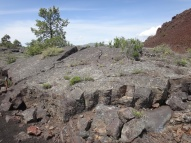 A pressure ridge is where the hot lava underneath pushes up on the cooled surface and tilts and cracks it
